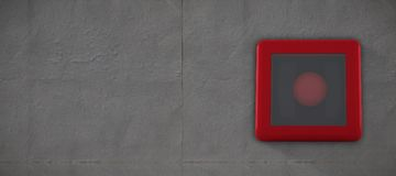 Composite image of fire alarm bell. Fire alarm bell against grey concrete tile Royalty Free Stock Image