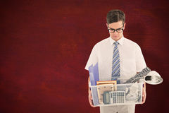 Composite image of fired businessman holding box of belongings Stock Photo