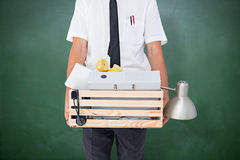 Composite image of fired businessman holding box of belongings Royalty Free Stock Photography