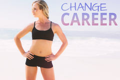 A Composite image of fit blonde standing on the beach Stock Photo
