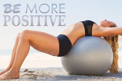 A Composite image of fit blonde stretching her back on exercise ball at the beach. Fit blonde stretching her back on exercise ball at the beach against be more Stock Photos