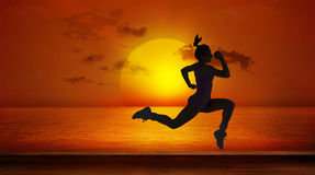 A Composite image of fit brunette running and jumping Royalty Free Stock Photography