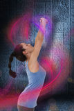 Composite image of fit brunette stretching her arms Stock Images