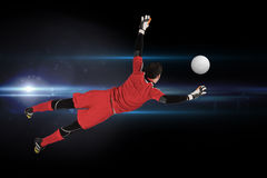 Composite image of fit goal keeper jumping up Royalty Free Stock Photography