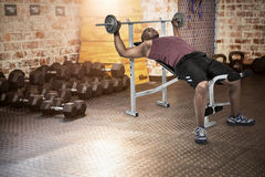 Composite image of fit man exercising with barbell Royalty Free Stock Photo