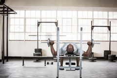 Composite image of fit man exercising with barbell Royalty Free Stock Photography