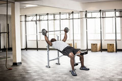 Composite image of fit man exercising with barbell Stock Photos