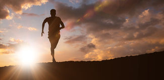 Composite image of fit man running against white background stock image