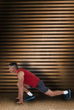 Composite image of fit man stretching his legs Stock Photography