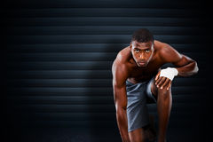 Composite image of fit muscular man Royalty Free Stock Photo