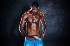 Composite image of fit shirtless young man Royalty Free Stock Image