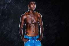 Composite image of fit shirtless young man Royalty Free Stock Photo