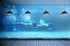 Composite image of fit swimmer training by himself Stock Photos
