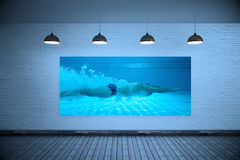 Composite image of fit swimmer training on his own Royalty Free Stock Photos