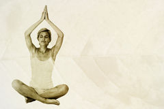 Composite image of fit woman doing yoga Stock Images