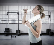 Composite image of fit woman drinking water Stock Photo