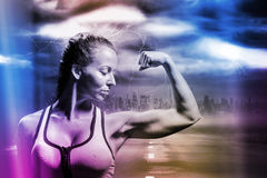 Composite image of fit woman flexing muscles Royalty Free Stock Image
