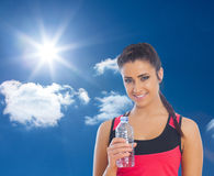 Composite image of fit woman holding water bottle Stock Photography
