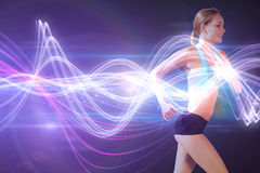 Composite image of fit woman jogging Royalty Free Stock Image