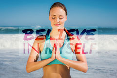 A Composite image of fit woman meditating on the beach Stock Photo
