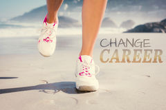 A Composite image of fit woman walking on the beach Royalty Free Stock Images