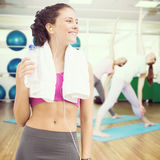 Composite image of fit woman with water royalty free stock photos