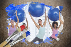 Composite image of fitness class at the gym Royalty Free Stock Images