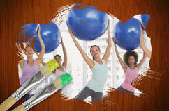 Composite image of fitness class at the gym Royalty Free Stock Photo