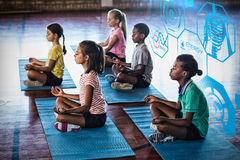 Composite image of fitness interface. Fitness interface against school kids meditating during yoga class Stock Photos
