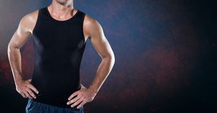 Composite image of Fitness man Torso against dark blackground Royalty Free Stock Images