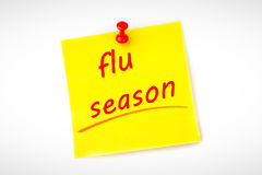 Composite image of flu season. Flu season against pinned adhesive note Stock Photography