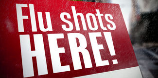 Composite image of flu shots here Royalty Free Stock Images