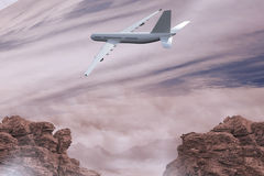 Composite image of flying airplane Stock Images
