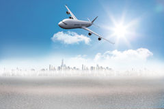 Composite image of flying airplane Stock Photos