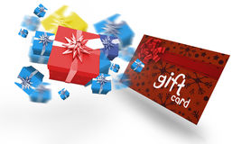 Composite image of flying christmas presents. Flying christmas presents against gift card with festive bow Stock Image