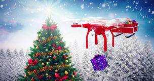Composite image of flying drone pulling chirstmas sledge Royalty Free Stock Photos