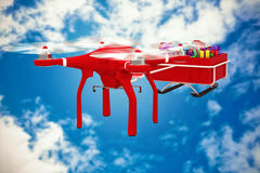 Composite image of flying drone pulling chirstmas sledge Stock Photography