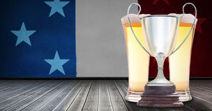 Composite image of focus on a trophy. Focus on a trophy against composite image of usa national flag royalty free stock images