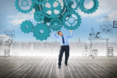 Composite image of focused businessman lifting up something heavy Stock Photos