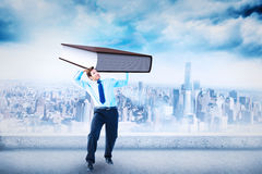 Composite image of focused businessman lifting up something heavy Royalty Free Stock Photography