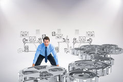 Composite image of focused businessman lifting up something heavy Royalty Free Stock Photo