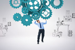 Composite image of focused businessman lifting up something heavy Stock Image