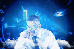 Composite image of focused businessman with magnifying glasses Royalty Free Stock Image