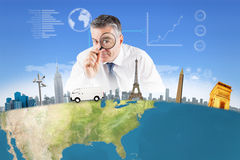 Composite image of focused businessman with magnifying glasses Stock Photography