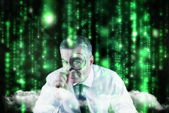 Composite image of focused businessman with magnifying glasses Stock Images