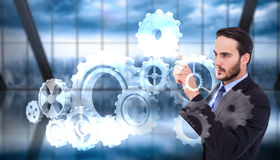 Composite image of focused businessman pointing in suit jacket Stock Images