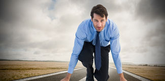 Composite image of focused businessman ready to race Stock Images