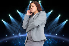 Composite image of focused businesswoman Stock Photography