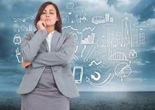 Composite image of focused businesswoman Stock Images