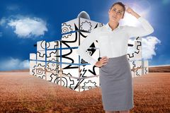 Composite image of focused businesswoman Royalty Free Stock Images